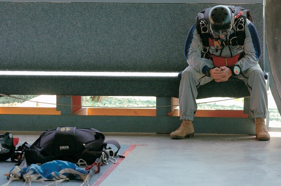 Skydiver Waiting on a Bench